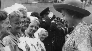 The Queen meets British Red Cross nurses during a walkabout outside Barnsley market in 1975 (PA)