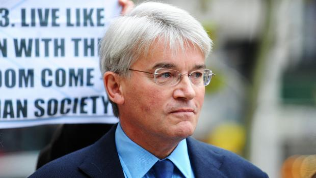 Former cabinet minister Andrew Mitchell MP arrives at the High Court in London, where he lost his libel action.