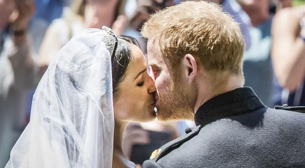 Meghan Markle and Prince Harry kiss on the steps of St George's Chapel on their wedding day (Danny Lawson/PA)