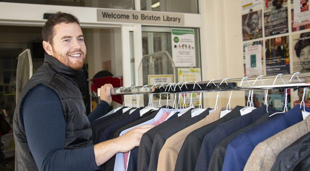 Matt Connelly with some clothes at Brixton Library (ihateironing/PA)