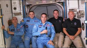 Bob Behnken, second from right, and Doug Hurley, far right, join the ISS's existing crew Chris Cassidy, centre, Anatoli Ivanishin, far left, and Ivan Vagner,second from left (Nasa/PA)