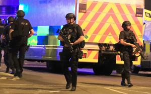 Armed police at Manchester Arena after reports of an explosion at the venue during an Ariana Grande gig. (Peter Byrne/PA Wire/PA Images)