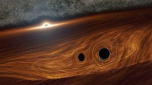 An artist's impression of a supermassive black hole and its surrounding disc of gas (Robert Hurt/Caltech/PA)