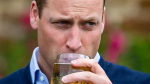 The Duke of Cambridge takes a sip of Aspall cider at The Rose and Crown pub (Aaron Chown/PA)