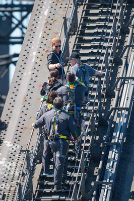 The Duke of Sussex (top) climbed the 464 steps to the top of Sydney Harbour Bridge with Australian Prime Minister Scott Morrison and Invictus Games competitors (Dominic Lipinski/PA)