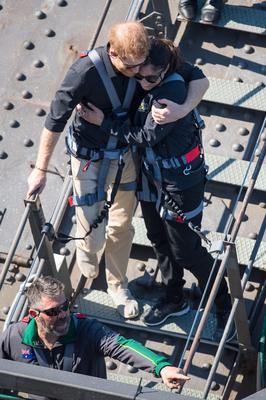 The Duke of Sussex hugs a fellow climber after scaling Sydney Harbour Bridge (Dominic Lipinski/PA)