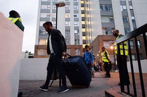 Residents leave the Taplow tower block on the Chalcots Estate (Stefan Rousseau/PA)