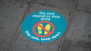 Social distancing advice on the pavement in Leicester where there has been a recent surge in coronavirus cases (Joe Giddens/PA)