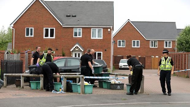 Police search recycling bins at the scene in Dexter Way, Gloucester (Aaron Chown/PA)