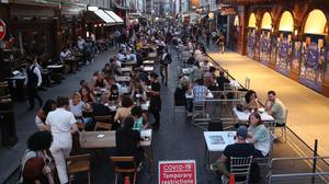 People drinking and dining out in Soho (PA)