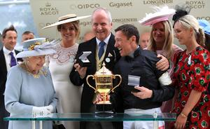The Queen presenting a trophy to jockey Frankie Dettori at Ascot in 2019 (Adam Davy/PA)