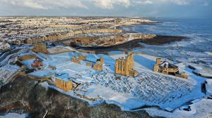 Snowfall over Tynemouth Priory in the North East (Snow dustings at Seaton Sluice Harbour in the North East (Owen Humphreys/PA)