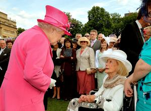 The Queen talks to Gena Turgel (92), who survived three Nazi concentration camps, at a garden party held at Buckingham Palace yesterday