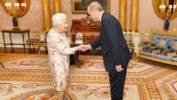 President of Turkey Recep Tayyip Erdogan is greeted by the Queen (John Stillwell/PA)