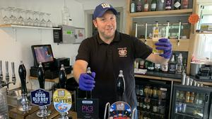 Neil Piddington, general manager of the Craufurd Arms community-owned pub in Maidenhead, checks the beer after Prime Minister Boris Johnson said that pubs, restaurants and cinemas in England will be able to reopen from July 4 (Pete Clifton/PA)