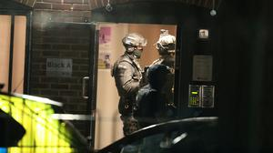 Armed police officers at a block of flats in Reading (Steve Parsons/PA)