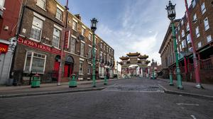 A deserted street in Liverpool's China Town (PA)