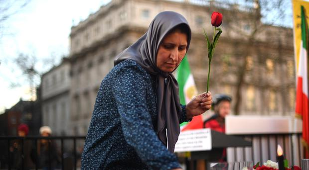 A vigil is held by The Anglo-Iranian Communities in the UK and supporters of the National Council of Resistance of Iran in Whitehall, London, for the passengers of the Ukrainian International Airlines flight (Victoria Jones/PA)