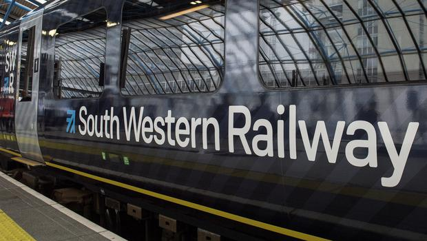 A near month-long strike by rail workers is set to go ahead after talks failed to resolve a long-running dispute over guards on trains (Victoria Jones/PA)