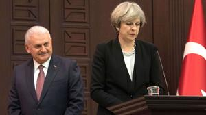 Prime Minister Theresa May, pictured at a press conference with Turkish prime minister Binali Yildirim, refused to condemn Donald Trump's ban on refugees