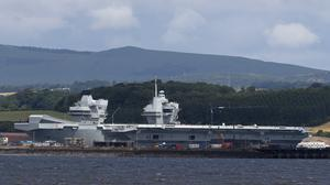 HMS Queen Elizabeth, one of two new aircraft carriers for the Royal Navy sits docked in the sunshine at Rosyth dockyard near Edinburgh (Andrew Milligan/PA)