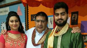 Nassar Hussain (centre) with his daughter Farah and son Adam (Family handout)