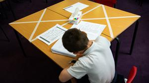File photo dated 18/5/2020 of social distancing measures as a child studies on a marked table at Kempsey Primary School in Worcester. The number of children returning to the classroom in England increased last week as more than two in three primary schools reopened their doors to more pupils, Government figures show.