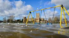 A playground is submerged in floodwater in Tewkesbury (Ben Birchall/PA)