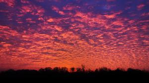 The sunrise over Holme Pierrepont, Nottinghamshire , as swathes of the country have been warned of icy conditions.