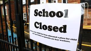 Ministers and teaching unions have been been urged to end 'squabbling' over schools reopening (Tim Goode/PA)