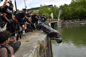 Protesters throw statue of Edward Colston into Bristol harbour (Ben Birchall/PA Wire)