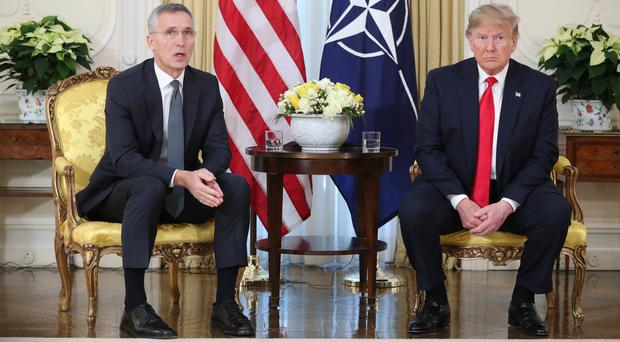US President Donald Trump holds a breakfast meeting with Nato Secretary General Jens Stoltenberg (Jonathan Brady/PA)