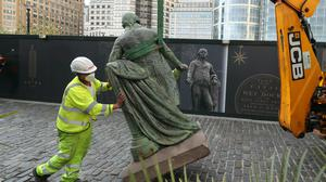 Workers take down a statue of slave owner Robert Milligan at West India Quay, east London (Yui Mok/PA)