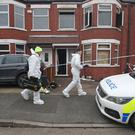 Forensics officers have been investigating the scene (Danny Lawson/PA)
