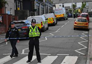 Police cordoned off the high street (Ben Birchall/PA)