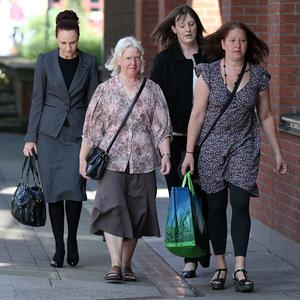 Maureen Greaves, front left, arrives at Sheffield Crown Court, where a man has been found guilty of killing her husband Alan