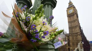 Flowers left on Westminster Bridge after the 2017 terrorist attack. The government has renewed its advice for offices and other public places to rehearse their responses to marauding terrorist attacks in the wake of last weekend's Reading stabbings (Lauren Hurley/PA)