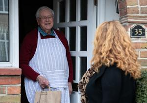 A volunteer makes a delivery of hot food for the Friday Lunch Club in Chichester (PA)