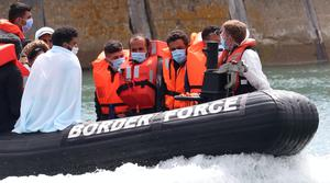 A Border Force vessel brings a group of men thought to be migrants into Dover, Kent, following a number of small boat incidents in the Channel (Gareth Fuller/PA)
