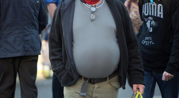 Being obese increases the risk of Type 2 diabetes (Daniel Leal-Olivas/PA)
