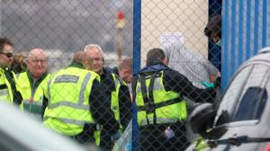 Officials process men thought to be migrants after they were brought into Dover (Gareth Fuller/PA)