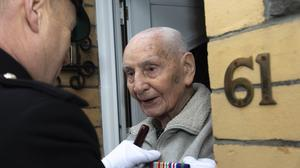 Glyn Gurner opened his door to be presented with replacement service medals (Corporal Tom Evans (RLC) / MoD Crown)
