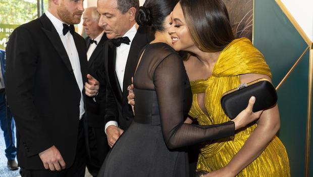 Harry chats to Disney boss Robert Iger while Meghan greets Beyonce at a film premiere where the duke told Mr Iger his wife did voiceovers (Niklas Halle'n/PA)