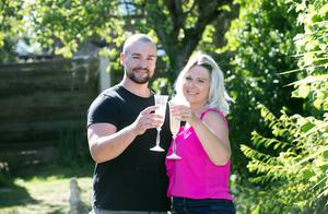 Rich Pearson, 30, and wife Kim, 33, of Upminster in East London, celebrate winning £10,000 per month for a year in the National Lottery's Set For Life draw. (National Lottery/ PA)