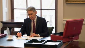 Chancellor Philip Hammond preparing his speech in Downing Street, London, ahead of the Budget.