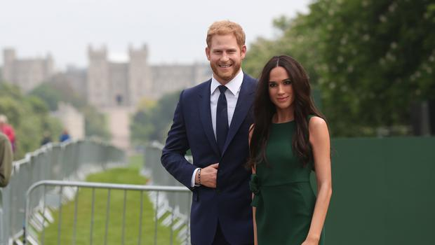 Madame Tussauds' wax figures of Prince Harry and Meghan Markle are paraded along the Long Walk in Windsor (Jonathan Brady/PA)