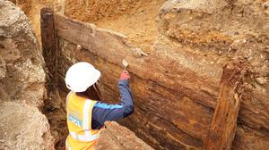 Archaeologists excavating the timber structure (Archaeology South-East/UCL/PA)