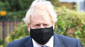 Prime Minister Boris Johnson during a visit to Tollgate Medical Centre in Beckton in East London (PA)