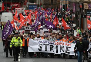 Workers marching through Glasgow for a rally at George Square (Andrew Milligan/PA)