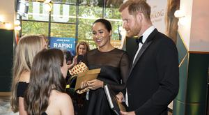 The Duke and Duchess of Sussex chat with children at the european premiere of Disney's The Lion King (PA)
